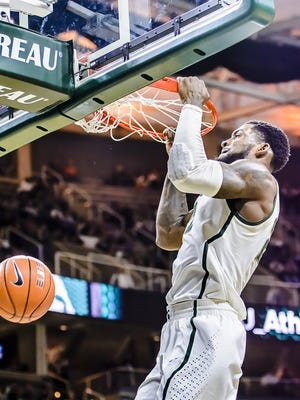 Branden Dawson dunks  during the first half of the Spartans' game with Eastern Michigan Wednesday at Breslin Center.