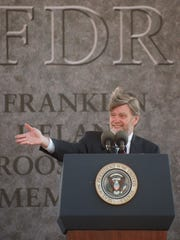 """David Roosevelt, President Franklin Delano Roosevelt's grandson and a member of the FDR memorial commission, gestures during an address during a dedication ceremony for the memorial in Washington on May 2, 1997. Roosevelt said, """"We gather to pay tribute not to a man, but to an era."""""""
