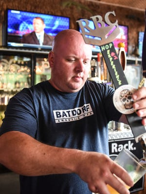Eric Stubbs, head brewer for Rotunda Brewing Company, pours a Hop Experience #2 at the Batdorf in Annville on Wednesday, Aug. 31, 2016.