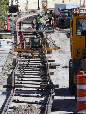 Workers are seen installing rails along Santa Fe Street near the intersection with Main Street in Downtown El Paso in September 2016.