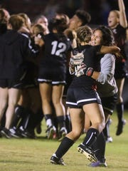 Stewarts Creek's Rachel Carter (16) and the goalie  Lena Alakabi celebrate beating Oakland with penatly kicks as the rest of the team celebrates during the 7-AAA semifinals at Siegel Soccer field  on Tuesday, Oct. 11, 2016.