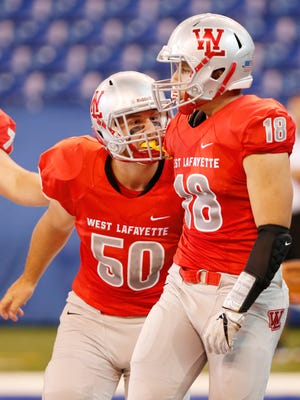 August Schott celebrates with Sage Hood after Hoods rushing touchdown at 10:49 in the first quarter against Rensselaer Saturday, September 16, 2017, at Lucas Oil Stadium in Indianapolis. Hood's touchdown put the Red Devils up 7-0 over the Bombers. West Lafayette would go on to win 55-6.