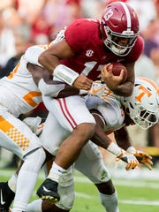 Alabama quarterback Tua Tagovailoa (13) fights his way into the end zone for a touchdown against Tennessee defensive back Theo Jackson (26) and defensive back Shawn Shamburger (15) in second half action at Bryant-Denny Stadium in Tuscaloosa, Ala. on Saturday October 21, 2017. (Mickey Welsh / Montgomery Advertiser)