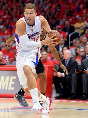 Los Angeles Clippers forward Blake Griffin (32) drives to the basket in the first half of game seven of the first round of the NBA Playoffs against the San Antonio Spurs at Staples Center.