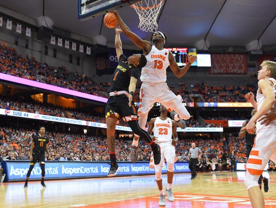 Syracuse Orange center Paschal Chukwu (13) blocks the