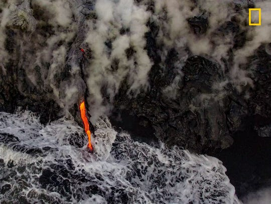 Molten Earth meets the ocean on the flanks of Kilauea volcano on the Big Island of Hawaii. A perspective not seen until the advent of drones, this interaction between lava, water, and time contributes to the buildup of an island chain.