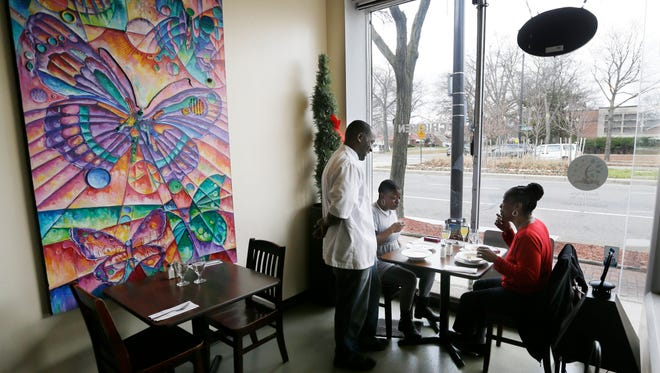 Don Studvent, chef/owner of 1917 American Bistro on Livernois Avenue, helps customers, Tuesday, Dec. 15, 2015 in Detroit. The restaurant abruptly shuttered the first week of 2018.