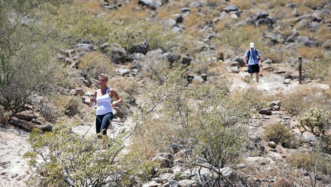 Hikers make their way down the Cholla Trail at Camelback Mountain in Phoenix in 2013.
