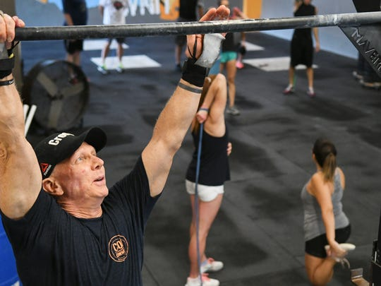 Ken Ogden works out at CrossFit OwnIt Friday in West Melbourne. Ogden, 63, will compete in the Reebok CrossFit Games this week in Wisconsin.