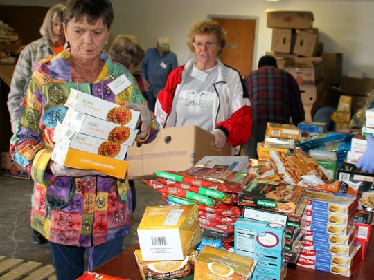 Local food distribution centers provide commodities solely through volunteer help as seen in this photo taken prior to the pandemic. The Veterans Assistance Center of Luna County recently closed operations due to the New Mexico health order. They are still assisting veterans and their families by calling the center at 833-551-0518. Press 8 for vets.