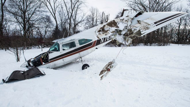 A single-engine plane rests in the front yard of a home on Dorset Street in Shelburne after an emergency landing there Friday, March 16, 2018. The pilot walked away from the crash and no one was injured.