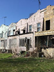 A stretch of abandoned homes near 4th Avenue and Broadway