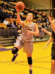 HSU's Kaitlyn Ellis drives to the basket during Saturday's