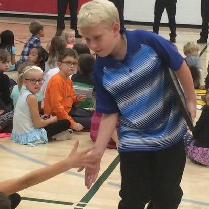Nine-year-old boy saves deaf father, wins award