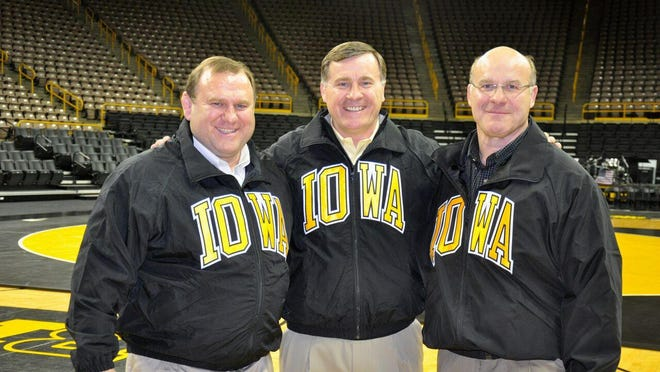 Ed Banach, left, Steve Banach, center, and Lou Banach, right, at Carver-Hawkeye Arena in 2014.