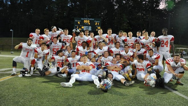 Team New Hampshire teammates celebrate after last year's 21-9 win over Vermont at Castleton College in Vermont.