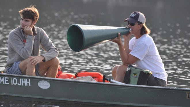 Wendy Wilbur yells out instructions at the Northeast Rowing Camp on Crescent Lake in Raymond, Maine.
