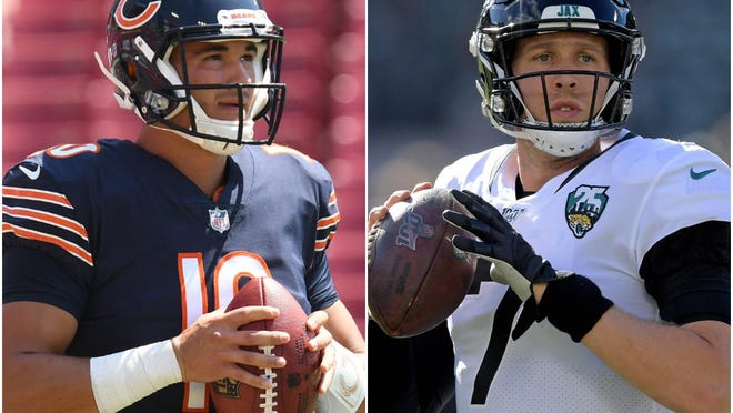 The Chicago Bears quarterbacking competition will be between Mitch Trubisky, left, and newcomer Nick Foles.