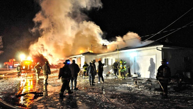 Firefighters from several communities helped out at the scene of the fire that engulfed the Kevin Schweiner home on Dec. 17. Tom Skubal/Kewaunee Fire Department