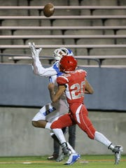 Bowie wide receiver Dominic Johnson catches a touchdown pass over Jefferson's Jesse Estebane Thursday at the Sun Bowl.