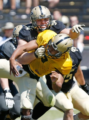 Jake Replogle of the Black team sacks Aaron Banks of the Gold team during the Purdue spring football game Saturday, April 16, 2016, at Ross-Ade Stadium. The Black team defeated the Gold 23-17.
