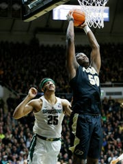 Caleb Swanigan sails in for a dunk past Kenny Goins of Michigan State Saturday, February 18, 2017, at Mackey Arena. Purdue defeated Michigan State 80-63.