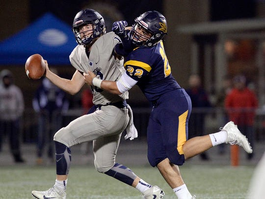 Victor's Chris Varone, right, sacks Pittsford's Colby