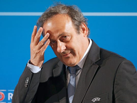 "FILE - In this Feb.22, 2014 file photo, UEFA President Michel Platini arrives at a press conference, one day prior to the UEFA EURO 2016 qualifying draw in Nice, southeastern France. Michel Platini will not challenge Sepp Blatter for the FIFA presidency, saying Thursday Aug.28, 2014  there was ""no shadow of doubt"" about his decision. The former France great was expected to avoid a contest against Blatter after a successful World Cup strengthened the FIFA president's position. (AP Photo/Lionel Cironneau, File)"