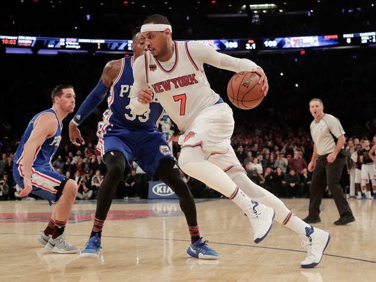 FILE - In this Feb. 25, 2017, file photo, New York Knicks forward Carmelo Anthony (7) drives the ball against Philadelphia 76ers forward Robert Covington (33) during the fourth quarter of an NBA basketball game in New York. The Knicks agreed to trade Anthony to the Thunder on Saturday, Sept. 23, 2017, saving themselves a potentially awkward reunion next week with the player they'd been trying to deal since last season.  New York will get Enes Kanter, Doug McDermott and a draft pick, a person with knowledge of the deal said. The person spoke with The Associated Press on condition of anonymity because the trade had not been announced.