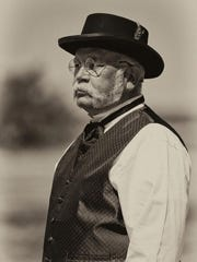 A vintage base ball umpire, Rich Heinick, is shown