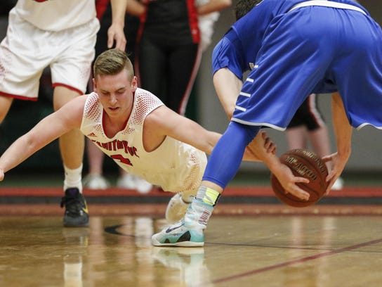 Lincoln's Braedon Bandt dives for a loose ball during