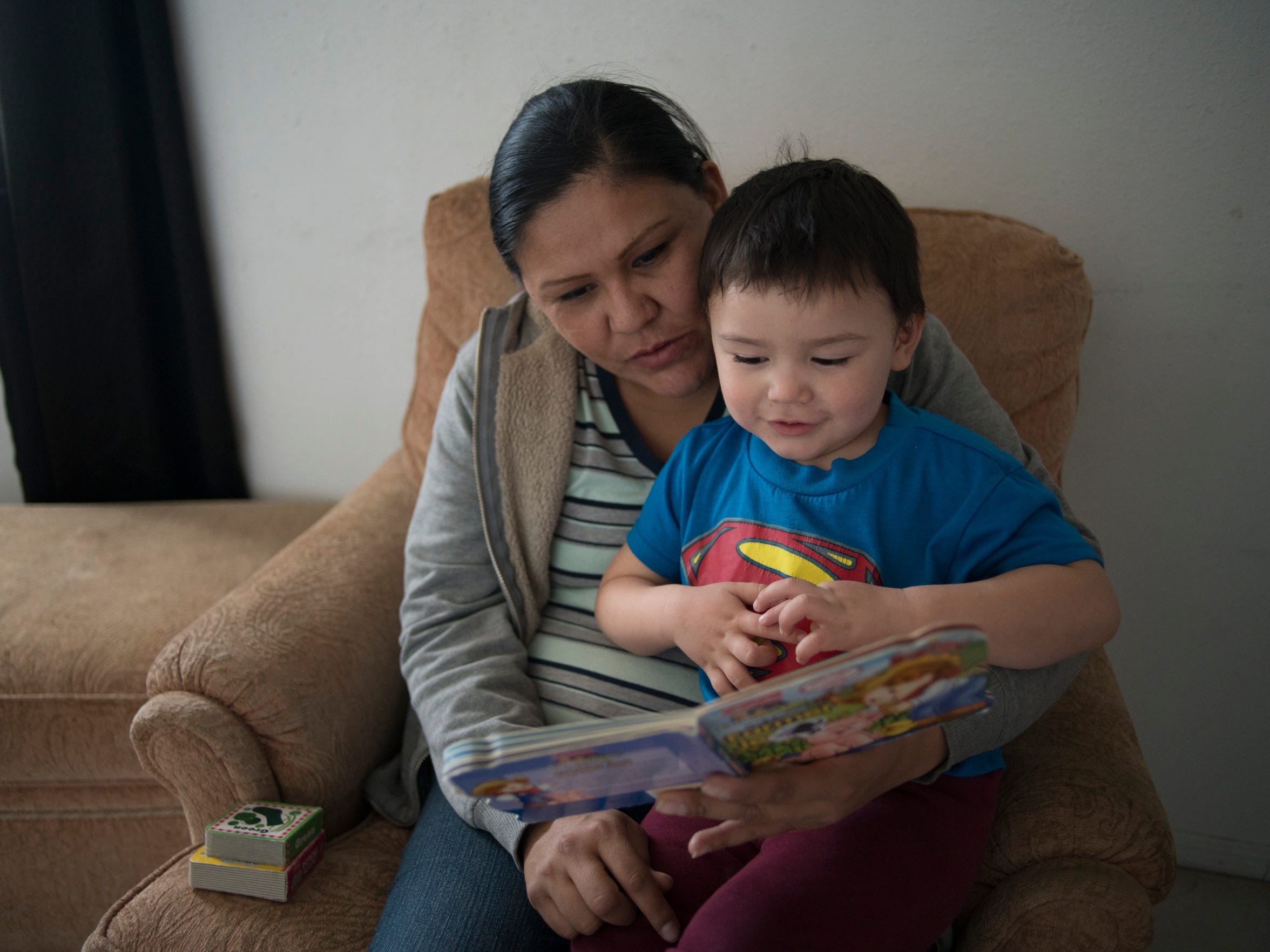 Rhonda Ramirez reads to her son Josiah Lucero, 2, in