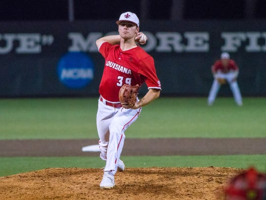 UL's Michael Leaumont throws a pitch to the batter as the Ragin' Cajuns take on the Little Rock Trojans at M.L. Tigue Moore Field on Saturday April 21, 2018.