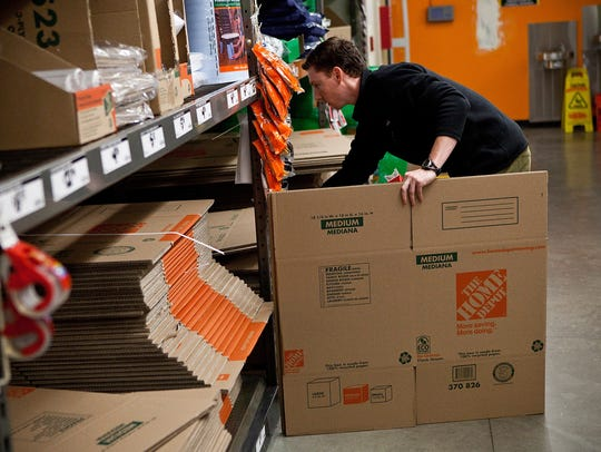 A customer shops at a Home Depot in New York.