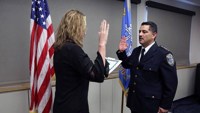 MaryNell Regan, Fire and Police Commission executive director, swears in Alfonso Morales as Milwaukee's interim police chief.