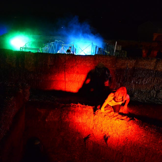 Flashing lights and sound effects add to the horror at the Maze of the Undead by Spirit Expedition at Fordyce Farm in Salem.