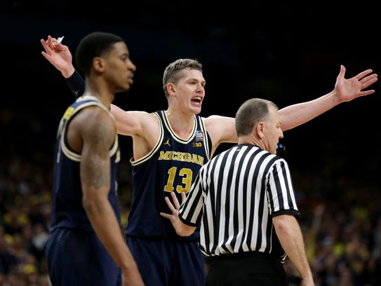 Michigan forward Moritz Wagner reacts after he was hit with a technical foul during the NCAA men's basketball title game on Monday, April 2, 2018, at the Alamodome in San Antonio.