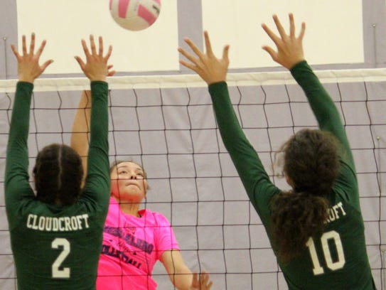 Mescalero's Alyn Kazhe-Kirgan, center, hits a ball