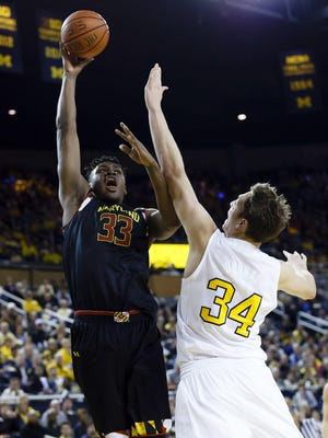 Maryland's Diamond Stone shoots over Wolverines forward Mark Donnal in U-M's 70-67 win Jan 12. Stone was serving a one-game suspension in the upset loss to Minnesota on Thursday. Back as a starter for today's game, he'll be a tough task for U-M defenders.