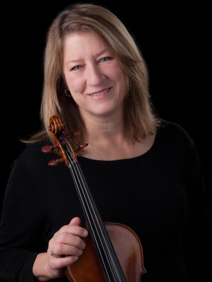 Violinist Laura Tomlin is the director of orchestras at Davidson Fine Arts Magnet School, the founder and director of Carolina Academy of Music and assistant concertmaster of the Augusta Symphony.