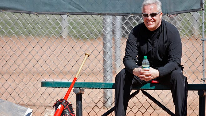 Reds Assistant General Manager Bob Miller watches a workout at spring training in February of 2012.