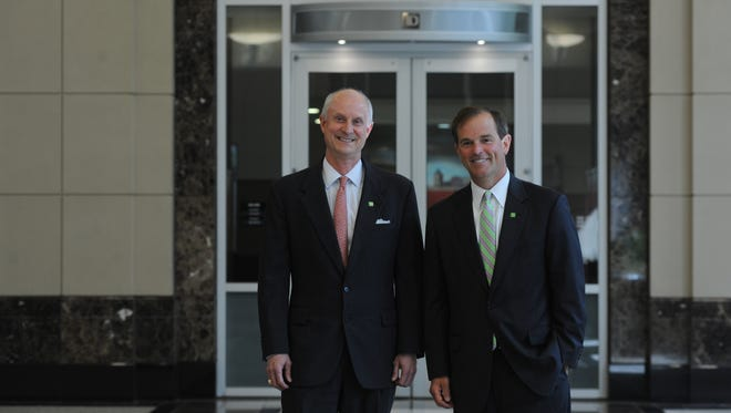 Rob Hoak, left, TD Bank regional president of the Carolinas, left, stands with Frank O'Brien, who is the new TD Wealth Market Lead for Metro Carolina, on Wednesday, June 25, 2014.