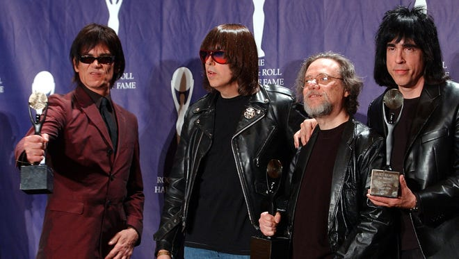 In this March 18, 2002, file photo, members of the Ramones, from left to right, Dee Dee, Johnny, Tommy and Marky Ramone hold their awards after being inducted at the Rock and Roll Hall of Fame induction ceremony at New York's Waldorf Astoria. A business associate says Tommy, the last surviving member of the original group, has died at the age of 62.
