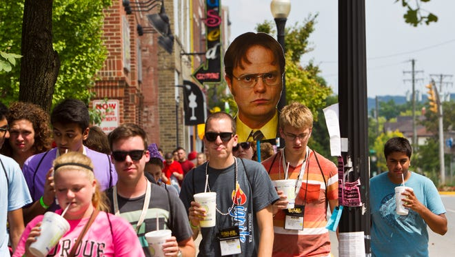 """Incoming freshman at Purdue University follow the likeness of Dwight Schrute from the television series """"The Office"""" during Boiler Gold Rush Monday, August 18, 2014, near campus in West Lafayette. The new students were touring the village area near the campus."""
