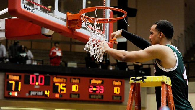Arsenal Tech forward Trey Lyles cuts down the net after beating Bloomington North 75-71 during the Class 4A Semistate game, Saturday, March 22, 2014, inside the Tiernan Center at Richmond High School.