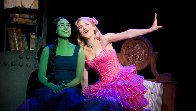 "Alison Luff and Jenn Gambatese perform in the 2013 production of ""Wicked."""