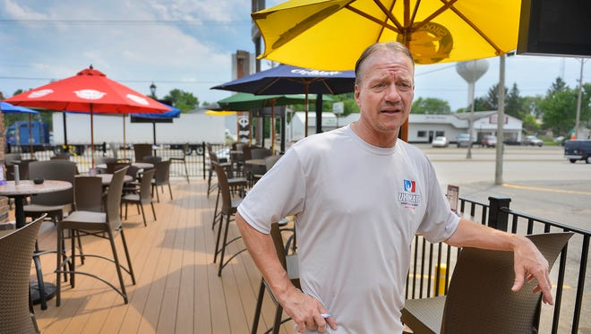 Ultimate Sports Bar & Grill Owner Tom Frericks says on Wednesday, June 11 that there is a special menu of both food and drinks on his business's newly-opened, add-on 1,300-square foot deck. Updates to the property are happening inside and out with a new entrance and a former liquor store on the property scheduled for demolition to make better sight lines and more room for parking.