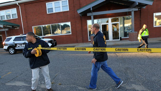 Federal agents investigate the offices of New England Compounding Center in Framingham, Mass., Tuesday, Oct. 16, 2012.
