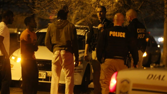 New Castle County police speak with bystanders after a person was shot in the foot in Knollwood shortly before 11:30 p.m. Friday.