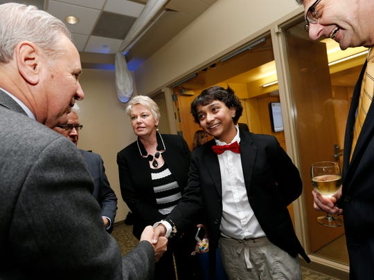 Quasar nominee Fez Zafar (center) shakes hands with